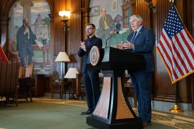 Governor Parson giving a briefing in the Governor's Office, an ASL interpreter stands nearby